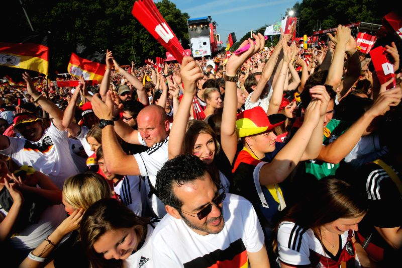 German football fans celebrate to mark their 2014 Brazil World Cup victory in Berlin, Germany, July 15, 2014. Germany's team returned home on Tuesday after winning ..