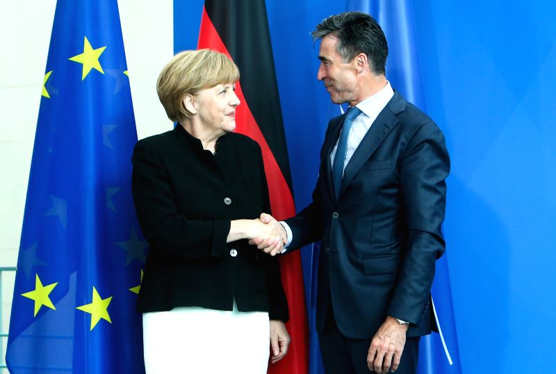 German Chancellor Angela Merkel (L) shakes hands with NATO Secretary General Anders Fogh Rasmussen during a press conference after their meeting at the chancellery in