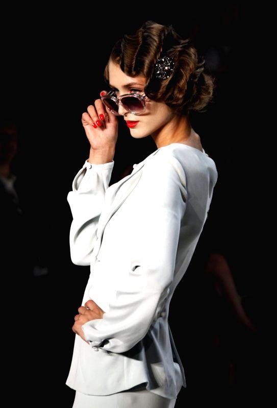 A model presents a creation by German brand designer Guido Maria Kretschmer,  at the Spring de02e95fb1