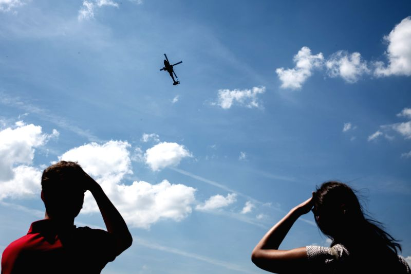 BERLIN, June 4, 2016 - People view the performance of an AH-64 Apache attack helicopter during the 2016 ILA Berlin Air Show in Berlin, Germany, on June 3, 2016. The 4-day ILA exhibition kicked off on ...