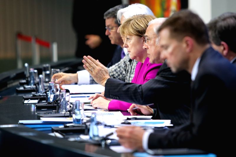 German Chancellor Angela Merkel (4th R) and  Secretary-General of the Organization for Economic Cooperation and Development (OECD) Angel Gurria (3rd R) attend a ...