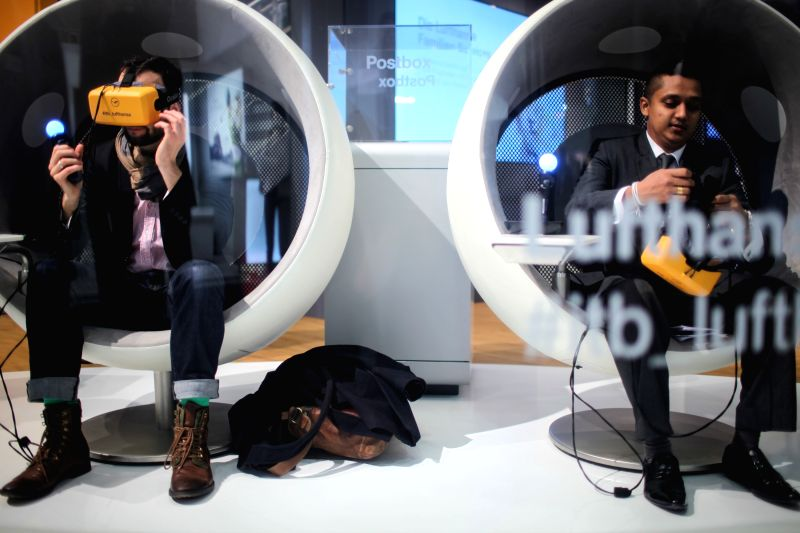 Visitors view virtual realities at the stand of the Lufthansa Airline during the Berlin International Tourism Fair (ITB), in Berlin, Germany, on March 4, 2015. ITB, ...