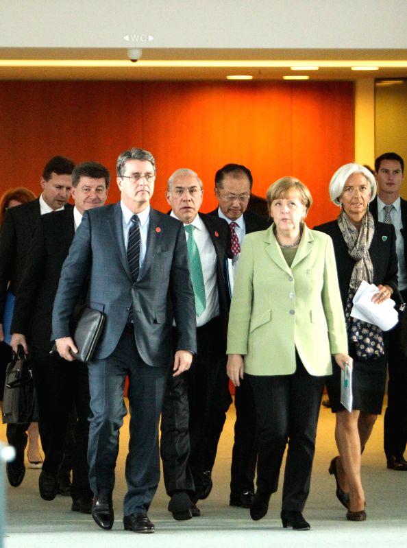 German Chancellor Angela Merkel (Front R),  Director-General of the World Trade Organization (WTO) Roberto Azevedo (Front L), the International Labor Organization ...