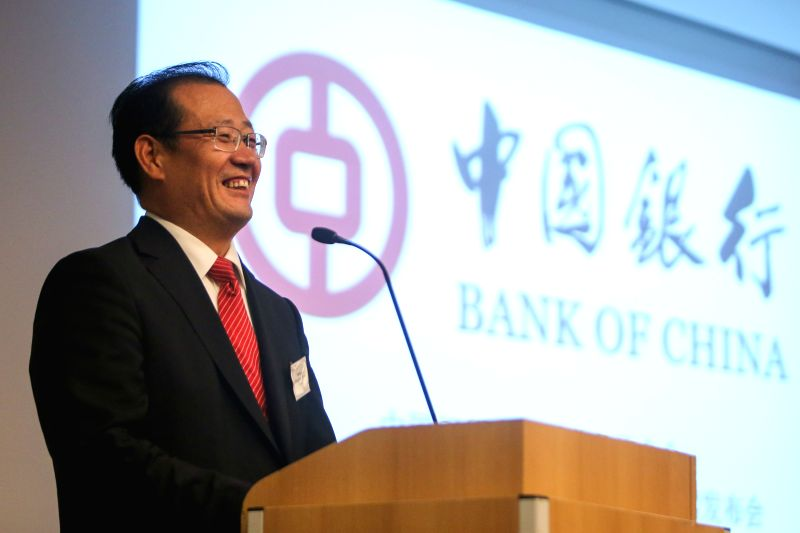 Li Guang, Managing Director of Bank of China Frankfurt Branch, speaks during a press conference in Berlin, Germany, on May 7, 2014. Bank of China, one of China's ...