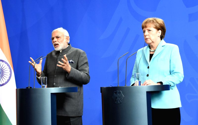 Prime Minister Narendra Modi addresses media during the Joint Press Statement, at Federal Chancellery, in Berlin, Germany on April 14, 2015. Also seen German Chancellor Angela Merkel. - Narendra Modi