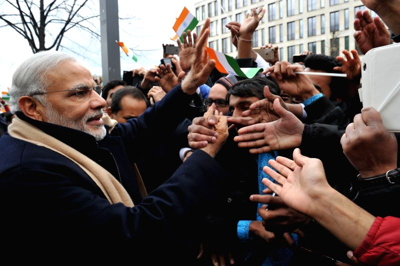 Prime Minister Narendra Modi interacts with the people, on his arrival, at Berlin, in Germany on April 13, 2015. - Narendra Modi
