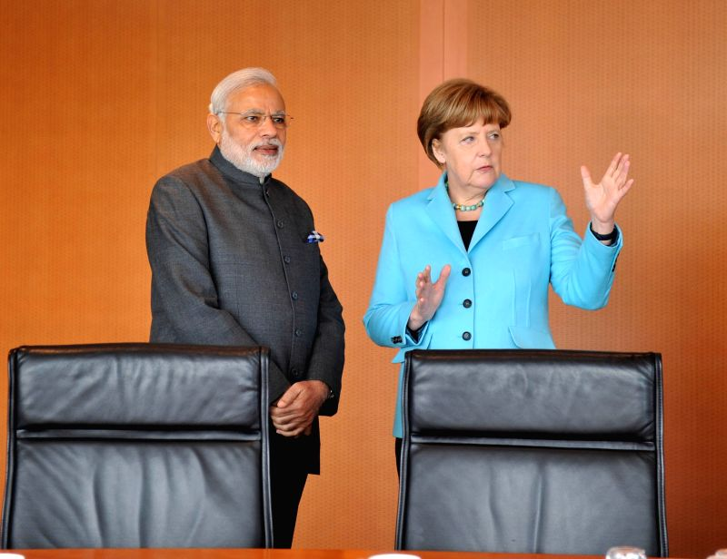 Prime Minister Narendra Modi with the German Chancellor Angela Merkel during the Working Lunch, at Federal Chancellery, in Berlin, Germany on April 14, 2015. - Narendra Modi