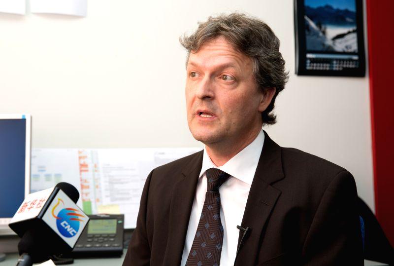 Christian Scharer, head of Division Inspectors of Swissmedic, receives Xinhua's interview in Bern, capital of Switzerland, April 21, 2015. Peter Balzli, head of ...