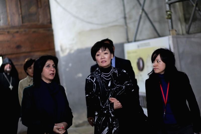 Akie Abe (C), wife of Japanese Prime Minister Shinzo Abe, visits the Church of the Nativity in the West Bank city of Bethlehem, on Jan. 20, 2015. (Xinhua/ Luay ... - Shinzo Abe