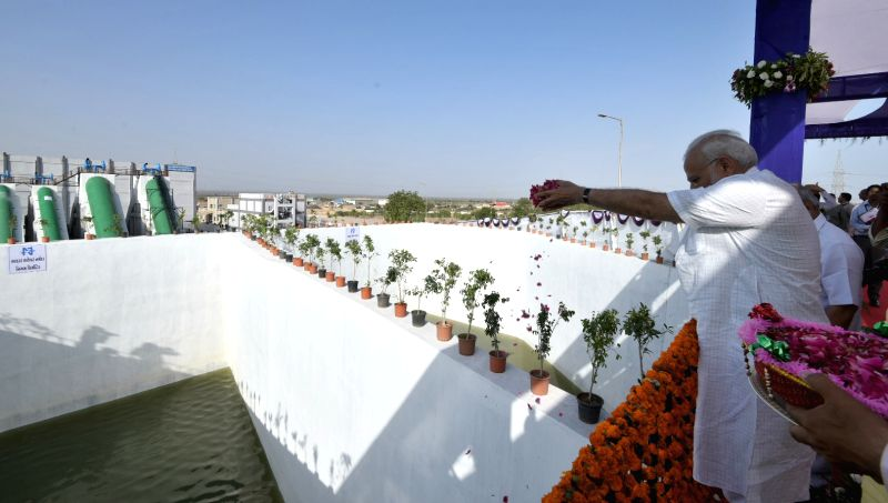 Bhachau (Gujarat):  Prime Minister Narendra Modi at the inauguration of pumping station for releasing Narmada waters into Tappar Dam, in Bhachau, Gujarat on May 22, 2017. - Narendra Modi