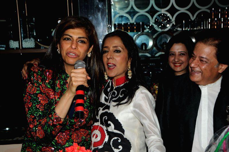 Bhajan singer Anup Jalota offer cake to wife Medha Jalota during the Medha Jalota's birthday party in Mumbai on June 25, 2014.
