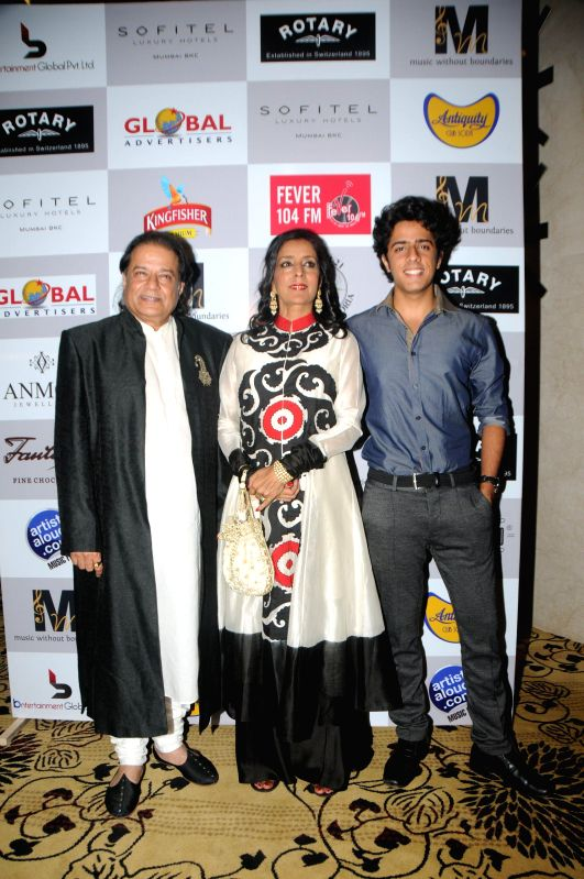 Bhajan singer Anup Jalota with wife Medha and son Aryaman during the Medha Jalota's birthday party in Mumbai on June 25, 2014.