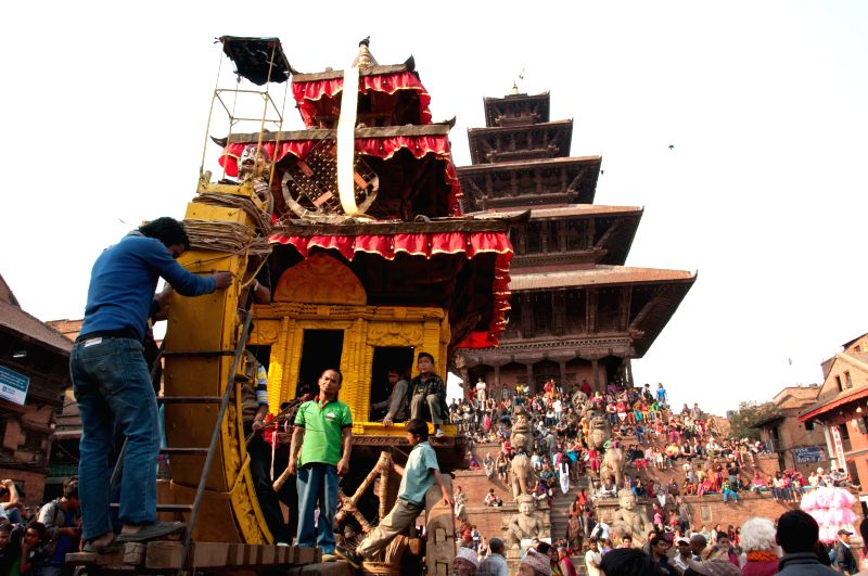People prepare to pull the chariot of god Bhairabhnath during Bisket Jatra festival at Bhaktapur, Nepal, April 10, 2014. Bisket Jatra festival is celebrated to ..