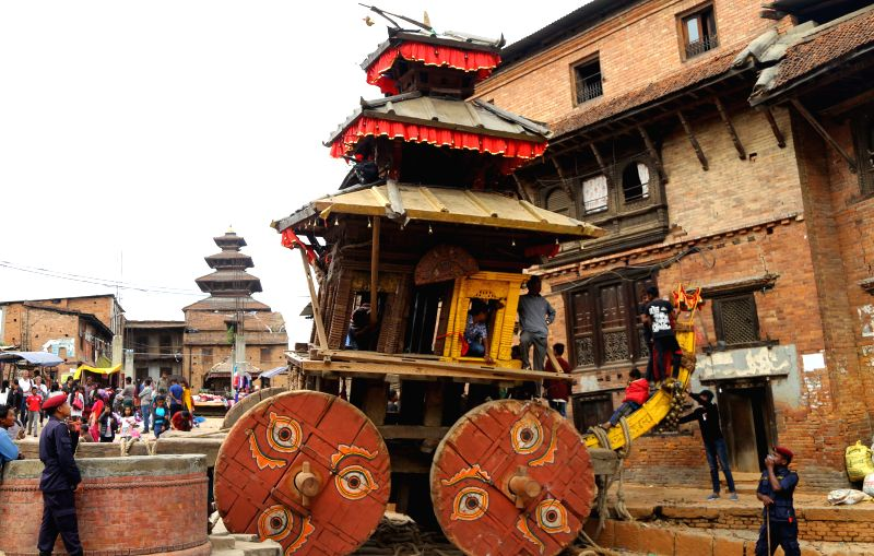 BHAKTAPUR, April 13, 2018 - Security personnel guard the chariot of Lord Bhairab as it was halted during the traditional Bisket Jatra festival in Bhaktapur, Nepal, April 12, 2018. The Bisket Jatra ...