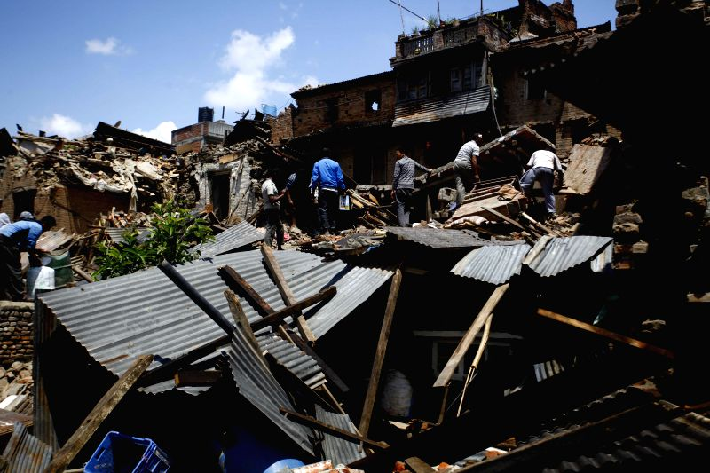 People collect their belongings from houses damaged by earthquake in Bhaktapur, Nepal, April 27, 2015. Death toll climbed to 3,815 following a massive ...