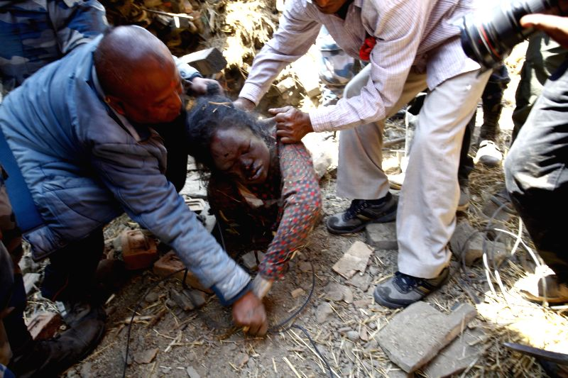 Rescuers retrieve a body from the debris in Bhaktapur, Nepal, April 27, 2015. Death toll climbed to 3,815 following a massive 7.9-magnitude earthquake in Nepal ...