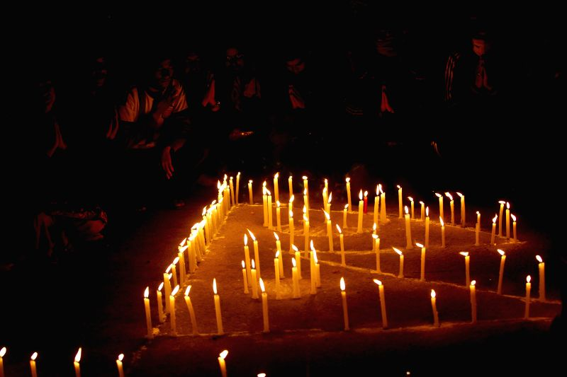 Nepalese people light candles and offer prayers for victims of Saturday's earthquake in Bhaktapur, Nepal, April 28, 2015. The death toll from a powerful ...