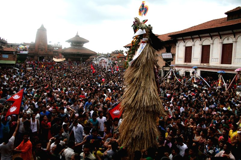 Devotees participate in a celebration to mark the Gaijatra Festival, or festival of cows, at Bhaktapur in Kathmandu, Nepal, Aug. 11, 2014. Hindus celebrated the ..