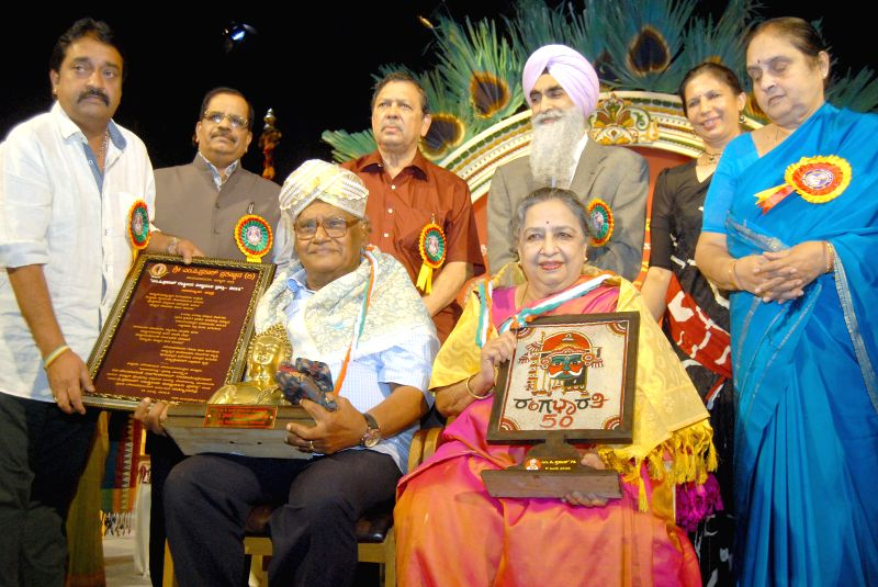 Bharata Ratna Dr. CNR Rao and his wife being felicitated during `Chinnara Belasu` organsied by Rangabharati at Ravindra Kalakshetra in Bangalore on July 11, 2014.
