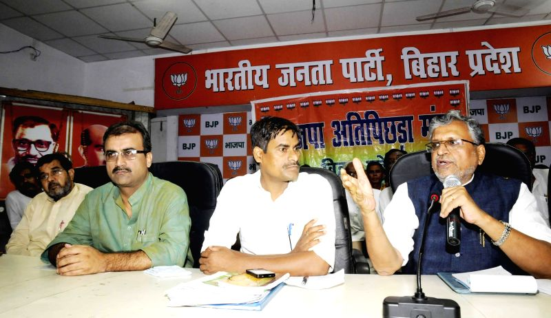 Bharatiya Janata Party (BJP) leader Sushil Kumar Modi addresses during a programme organised at party office in Patna on July 7, 2014.