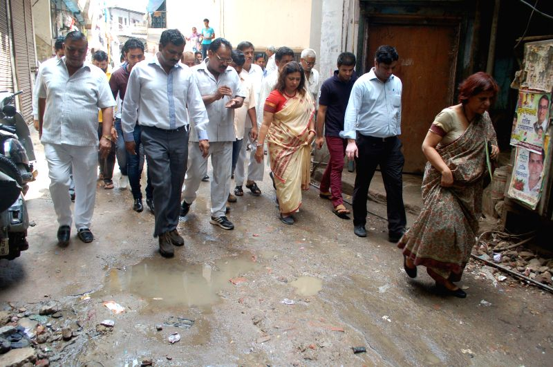 Bharatiya Janata Party (BJP) MP Meenakshi Lekhi at Old Pilanji village in her constituency in New Delhi on Sept 4, 2014. She has adopted the area  to develop it as a model village under a scheme ... - Narendra Modi