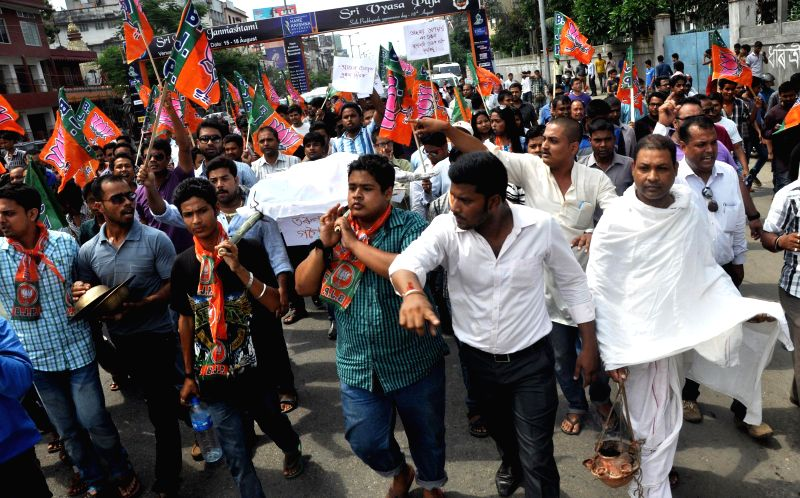 Bharatiya Janata Party (BJP) workers demonstrate during a 12-hour Assam bandh, called to protest against recent violence in Golaghat of Assam, in Guwahati on Aug 21, 2014.