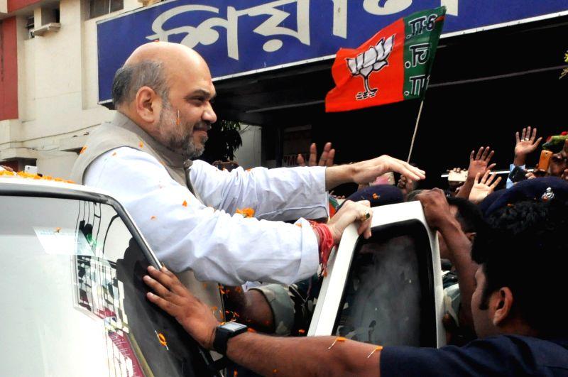 Bharatiya Janata Party president Amit Shah greeting supportes on his arrival at Sealdah railway station in Kolkata on April 26, 2017. - Amit Shah