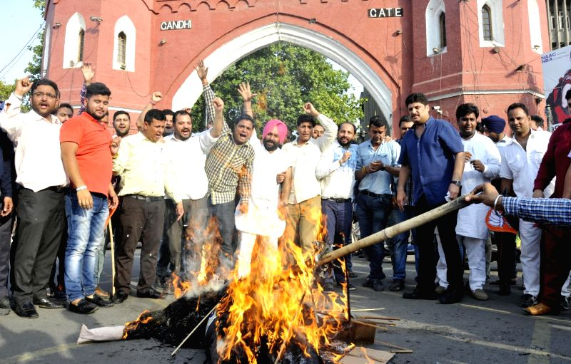 Bharatiya Janata Yuva Morcha activists stage a demonstration against Punjab Chief Minister Captain Amarinder Singh in Amritsar, on May 29, 2017. - Captain Amarinder Singh