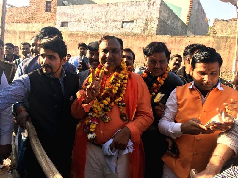 Bhartiya Janata Party's Navin Jain celebrates his victory in the recently concluded civic body polls in Agra on Dec 1, 2017. - Navin Jain
