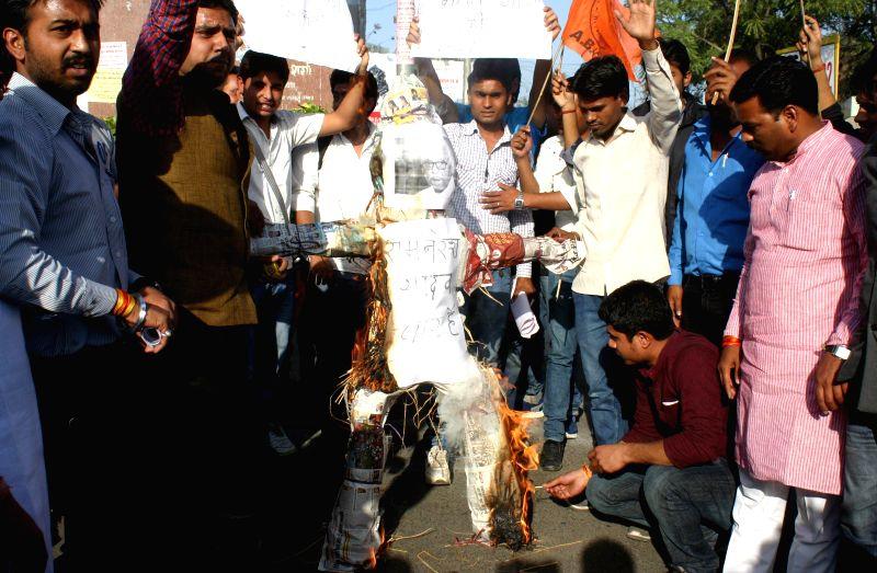 ABVP workers burn effigies of Madhya Pradesh Governor Ram Naresh Yadav in Bhopal, on Feb 18, 2015. - Naresh Yadav