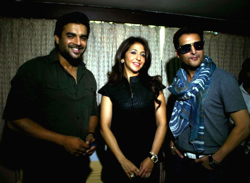 Actors R Madhavan and Jimmy Shergill with producer Krishika Lulla at the special screening of their film `Tanu weds Manu returns` in Bhopal on May 2, 2015.