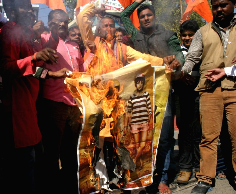 Bajrang Dal workers burn posters of Amir Khan starrer film `PK` during a demonstration in Bhopal, on Dec 29, 2014. - Khan