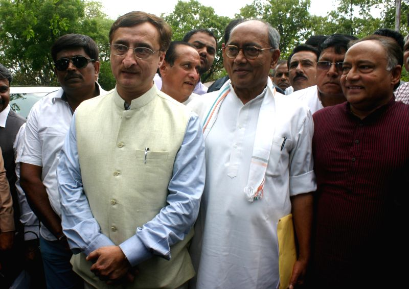 Congress general secretary Digvijaya Singh, senior Supreme Court lawyer Vivek Tankha and others arrive at SIT office to meet SIT Chairman Justice (Retd) Chandresh Bhushan - probing PEB scam- ...