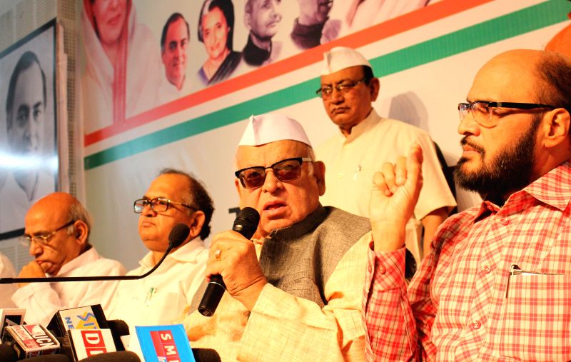 Congress leader Aziz Qureshi addresses a press conference in Bhopal, on April 8, 2015.