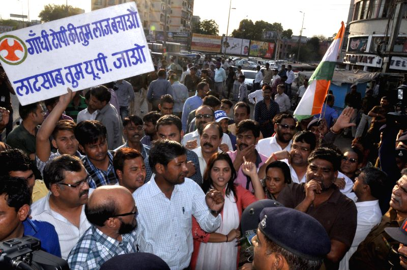 Congress workers stage a demonstration against Madhya Pradesh governor Ramnaresh Yadav in Bhopal, on Feb 24, 2015. - Ramnaresh Yadav