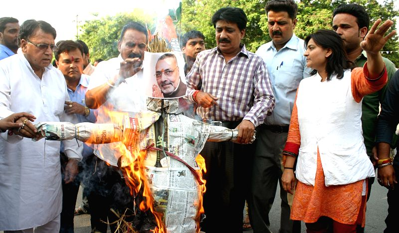 Congress workers stage a demonstration against Union Minister of State for Micro, Small and Medium Enterprises Giriraj Singh's remark that the Congress accepted Sonia Gandhi as its leader as ... - Enterprises Giriraj Singh