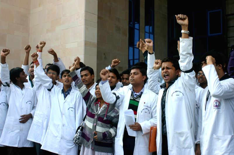 Junior doctors of AIIMS, Bhopal, shouting slogans during a demonstration to protest against AIIMS administration in Bhopal on Feb. 3, 2015.