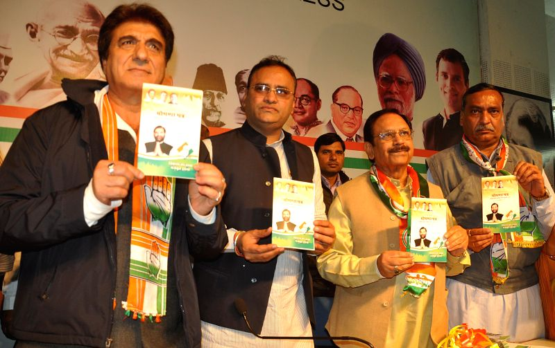 (L-R) Film actor and politician Raj Babbar, state congress president Arun Yadav, senior congress leader Suresh Pachouri, former Mayor Sunil Sood releasing party manifesto for civic body polls - Arun Yadav