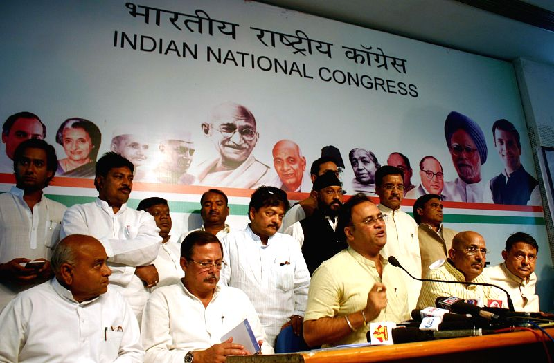 Madhya Pradesh Congress Chief Arun Yadav,  leader of opposition in the Madhya Pradesh Assembly Satyadev Katare and others during a press conference in Bhopal, on Feb 26, 2015.