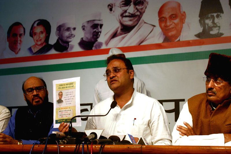Madhya Pradesh Congress chief Arun Yadav and the leader of opposition in the state assembly  Satyadev Katare during a press conference in Bhopal, on March 16, 2015. - Arun Yadav