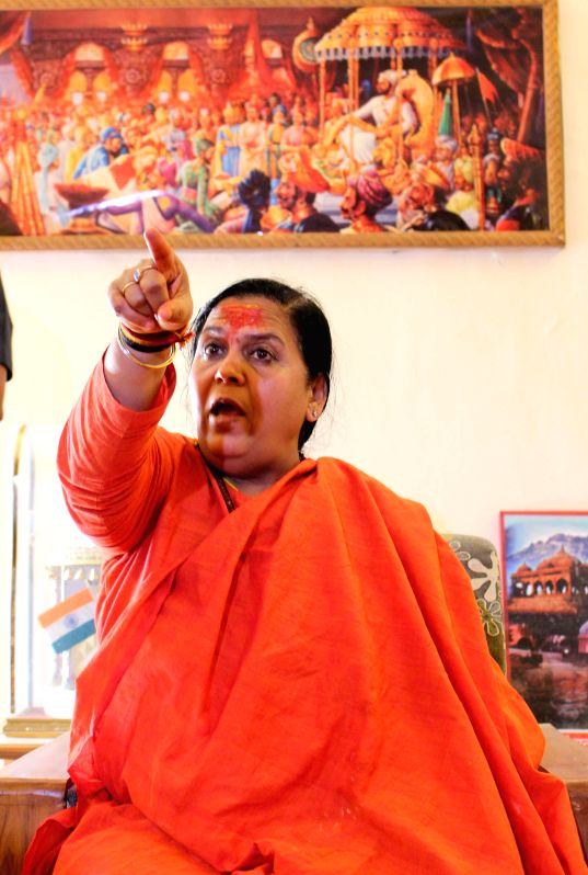 Union Minister for Water resource, River Development and Ganga Rejuvenation Uma Bharti talks to press regarding Madhya Pradesh recruitment scam in Bhopal, on Feb 17, 2015.