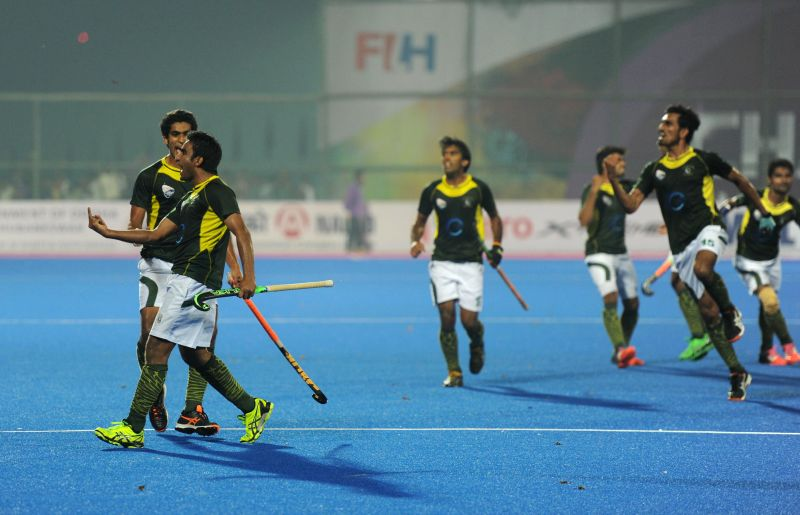 A Pakistani hockey player making an indecent gesture while celebrating after winning the match against India at the semifinal of the Champions Trophy at Kalinga Stadium in Bhubaneswar on