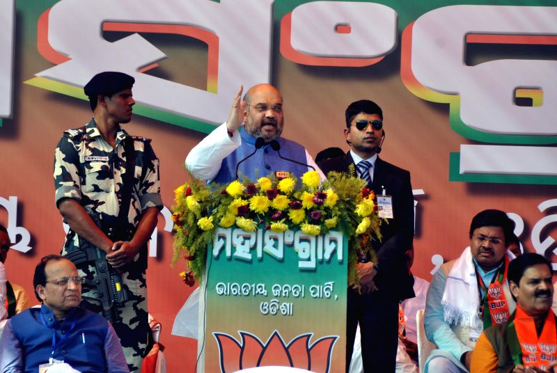 BJP chief Amit Shah addresses a party rally in Bhubaneswar, on Jan 6, 2015. (Photo : IANS)
