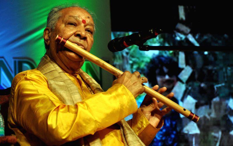 Flautist Hariprasad Chaurasia performs during the 5th foundation day of Vrindaban Gurukul in Bhubaneswar, on Feb 15, 2015. (Photo : Arabinda Mahapatra/IANS)