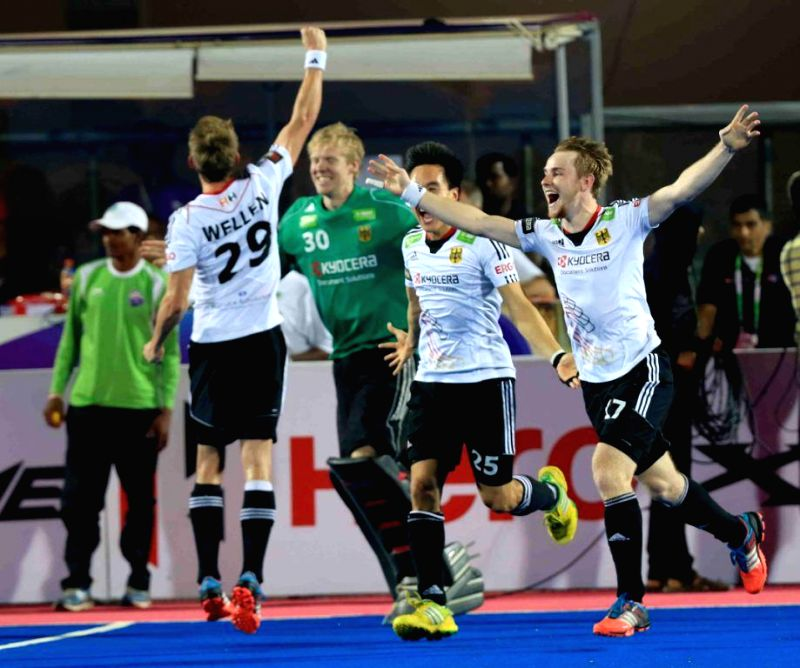 German players celebrate after winning the Hero Hockey Men`s Champions Trophy 2014 at Kalinga Stadium in Bhubaneswar, on Dec 14, 2014. (Photo : IANS)