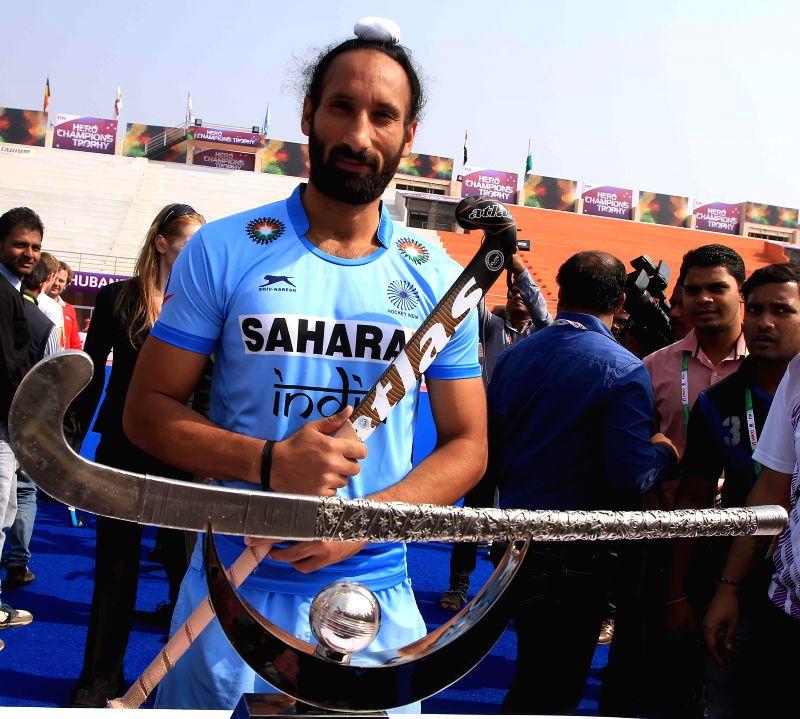Indian hockey captain Sardar Singh during a programme organised to unveil the trophy of `Hero Men`s Champions Trophy 2014` at Kalinga Stadium in Bhubaneswar on Dec 5, 2014. - Sardar Singh