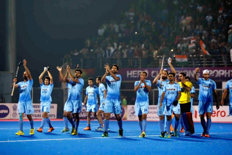 Indian players celebrate after their victory over Belgium during a HHCT - 2014 (Hero Hockey Men`s Champions Trophy 2014) match between India and Belgium at Kalinga Stadium in Bhubaneswar