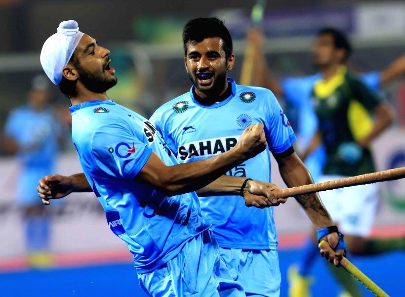 Indian players celebrate during a HHCT - 2014 (Hero Hockey Men`s Champions Trophy 2014) match between India and Pakistan at Kalinga Stadium in Bhubaneswar on Dec 13, 2014. Pakistan won. .