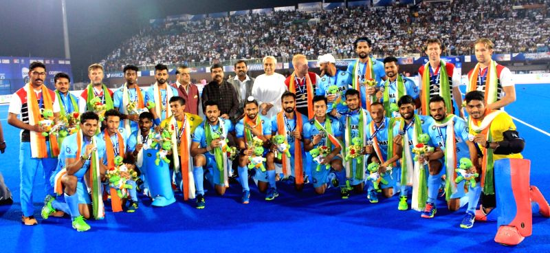 : Bhubaneswar: Indian players with Odisha Chief Minister Naveen Patnaik after winning bronze-medal playoff of the Hockey World League (HWL) Final against Germany at the Kalinga Stadium in ...