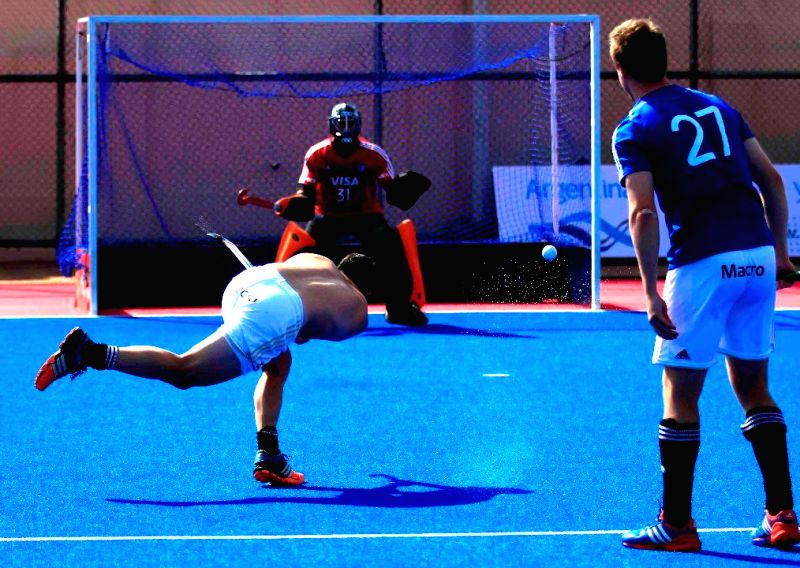 Members of Argentine Hockey team during a practice session at Kalinga Stadium in Bhubaneswar, on Dec 3, 2014. (Photo : IANS)